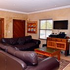 The lounge with DSTV Premium and DVD player.